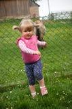 Girl walking on grass. Little preschool girl walking on grass Royalty Free Stock Photography
