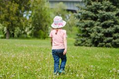 Girl walking on the grass with dandelions Royalty Free Stock Photography