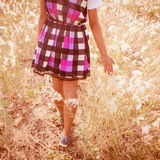 Girl Walking In Grass Field Royalty Free Stock Images