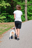 Girl Walking Her Dog Royalty Free Stock Photo