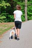 Girl Walking Her Dog royalty free stock photo