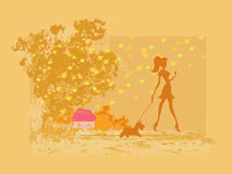 Girl walking with her dog in autumn Stock Photos