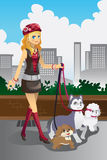 Girl Walking Her Dogs Royalty Free Stock Images