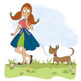 Girl walking her little dog Royalty Free Stock Images