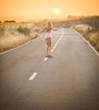 Girl walking with her skateboard 2 Royalty Free Stock Photography