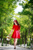 Girl walking and holding  flowers Stock Photos