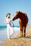 Girl walking with horse Royalty Free Stock Photography