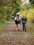 Girl Walking With Horse Stock Image