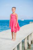 Girl walking on jetty Royalty Free Stock Photography
