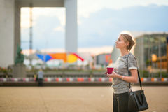 Girl walking at La Defense in Paris Royalty Free Stock Photos