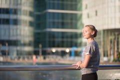 Girl walking at La Defense in Paris Stock Photos