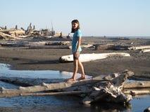 Girl walking on a log Stock Image