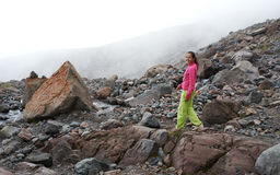 The girl walking in  majestic mountain stones Royalty Free Stock Photo