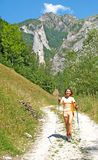 Girl walking in the mountains Stock Photo