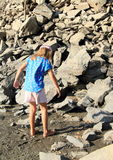 Girl walking in mud Royalty Free Stock Images