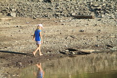 Girl walking in mud Royalty Free Stock Photos
