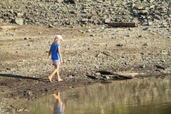 Girl walking in mud Royalty Free Stock Photos