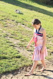 Girl walking in mud Stock Photo