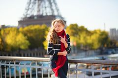 Girl walking near the Eiffel tower Royalty Free Stock Photo