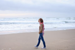 Girl walking near ocean Stock Images