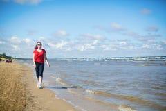 Girl walking near the sea in Jurmala Royalty Free Stock Photos