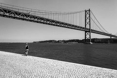 Girl walking near the Vasco Da Gama bridge Royalty Free Stock Photography