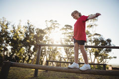 Girl walking on obstacle during obstacle course stock photos