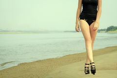 Girl walking on the ocean beach Stock Photo