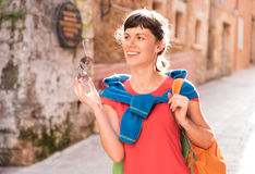 Girl walking in old town stock image