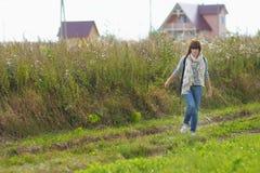 Girl walking outdoor Royalty Free Stock Photos