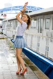 Girl walking outdoor on embankment Royalty Free Stock Photo