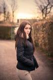 Girl walking outdoors Stock Photo