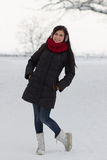 Girl walking outdoors in winter Stock Image