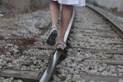 Girl walking over rail path Stock Image