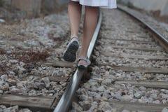 Girl walking over rail path. A girl walks over the railway path near the village of bunyola, in the Spanish island of Mallorca Stock Image