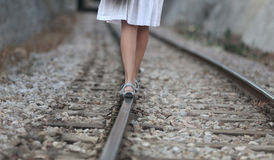 Girl walking over rail path. A girl walks over the railway path near the village of bunyola, in the Spanish island of Mallorca Royalty Free Stock Images