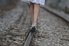 Girl walking over rails. A girl walks over the railway path near the village of bunyola, in the Spanish island of Mallorca Stock Images