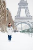 Girl walking in Paris on a winter day Royalty Free Stock Photo