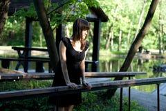 Girl walking in park Stock Images