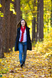 Girl walking in the park Stock Photo