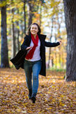 Girl walking in the park Royalty Free Stock Image