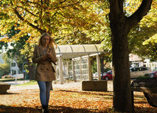 Girl walking in a Park. On a autumn day Stock Photos
