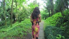 Girl walking in park stock video footage