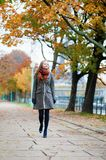 Girl walking in a park Royalty Free Stock Photos