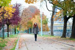 Girl walking in a park Royalty Free Stock Images