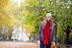 Girl walking in park on a fall day Royalty Free Stock Photography