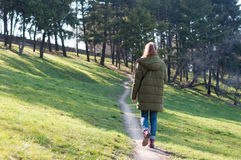 Girl walking on the park path Stock Photos