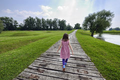 Girl walking on a path Royalty Free Stock Images