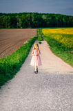 Girl walking Stock Images