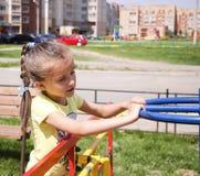 Girl walking on the Playground. Little girl walking on the Playground Royalty Free Stock Image
